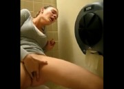 Cute Amateur Girl Masturbates in Public Toilet