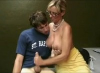 Hot busty MILF with glasses gives handjob to horny shy guy