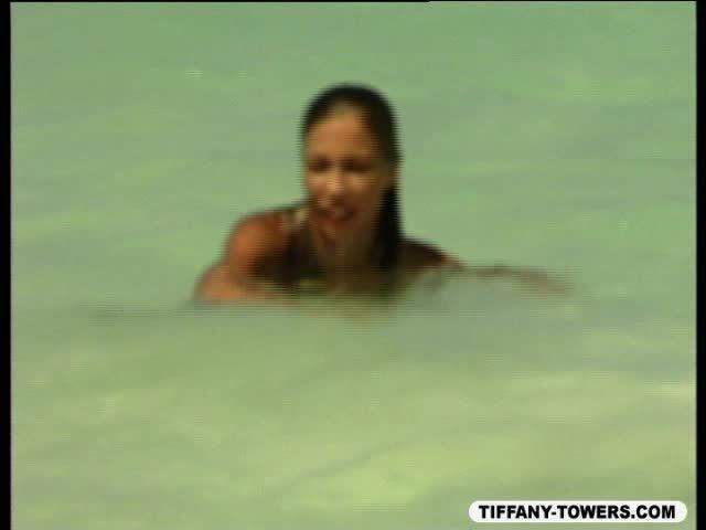 Towers running and swimming at beach