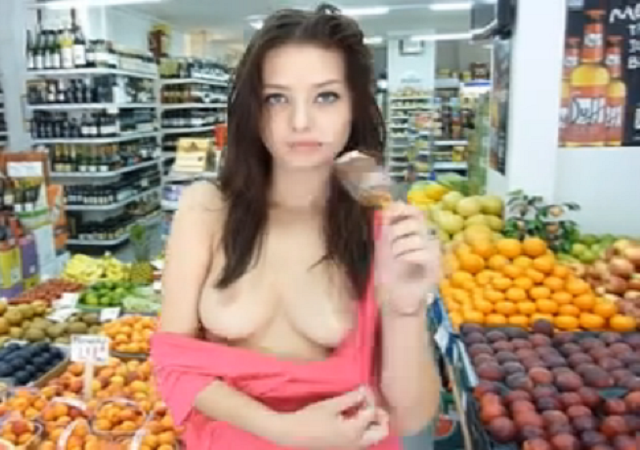 Cute young brunette and her ice-cream in public