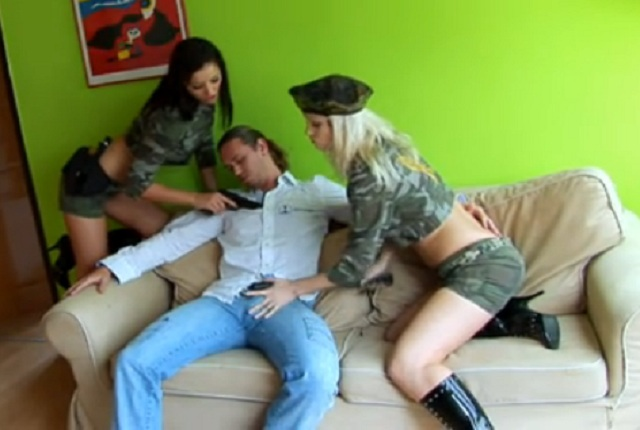Two girls in military uniform ride the cock