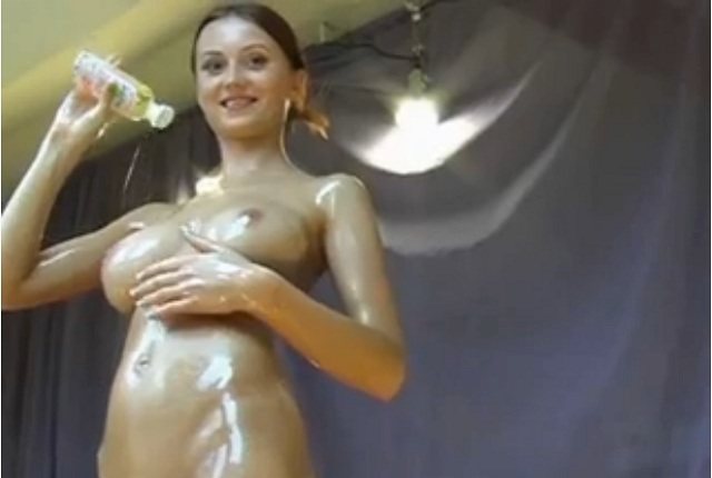Dirty Lilly oiled up her big tits and sexy body